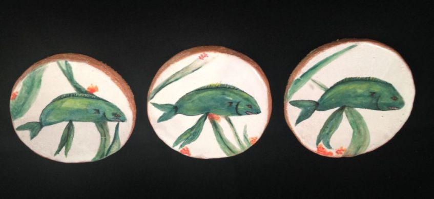Handmade and decorative ceramic fish art tiles.