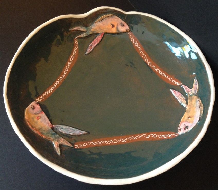 Glazed fish bowl in white earthenware, with painted fish. SOLD.