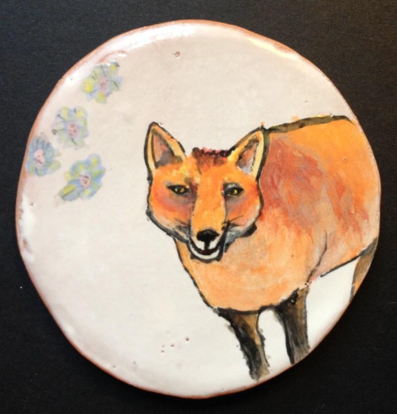 Red fox decorative item using maiolica technique.