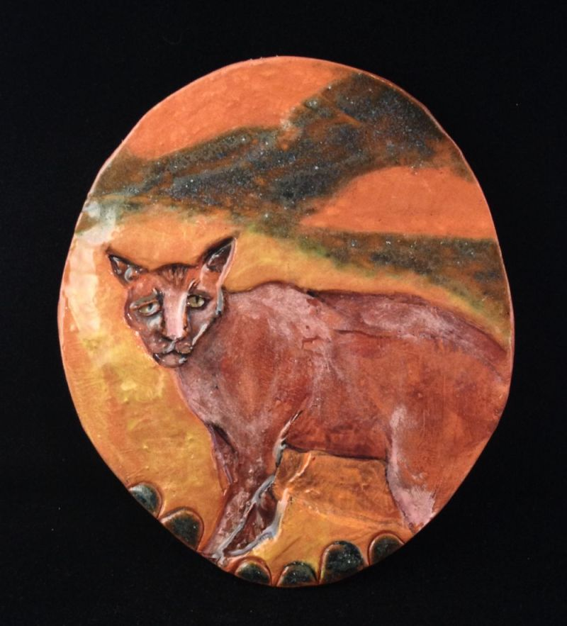 Yellow oval cat plaque.