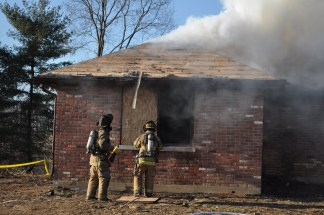 Materials likely to produce toxic emissions are removed from the structure prior to the training, such as roofing shingles.