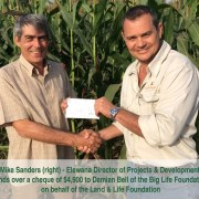 Mike Sanders hands over the cheque to Damien Bell