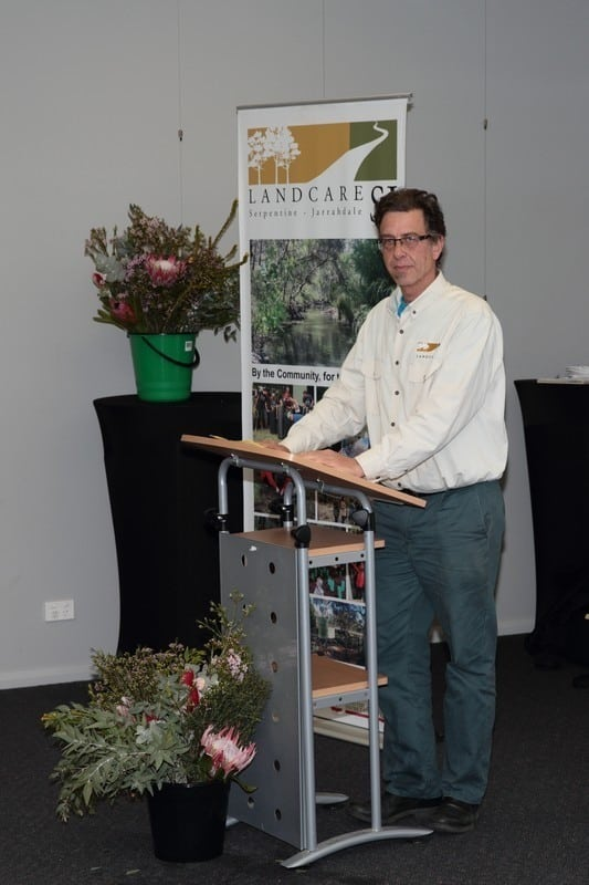 man standing at lectern
