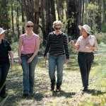 four women walking through a paddock in Jarrahdale for the Healthy Habitats program