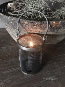 Zwarte metalen windlicht met kaarsenhouder