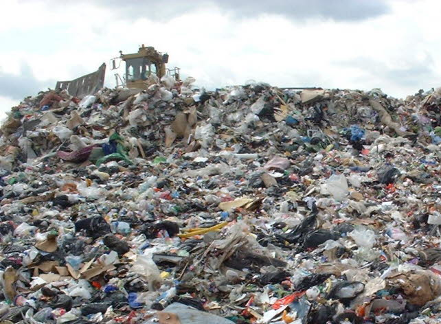 picture of landfill compactor and waste