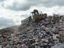 A Landfill Compactor on a Skyline of Waste