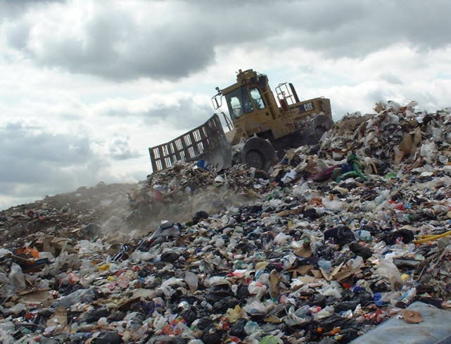picture of landfill compactor on brow of waste26