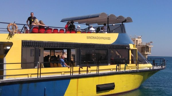 Excursion to the submarine Sindbad in Hurghada: tourists on the yacht to the submarine