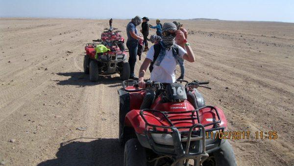 Desert Safari in Hurghada: Tourists ride on quad bikes