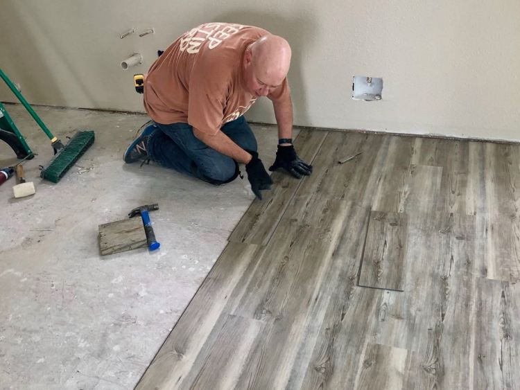 David laying flooring