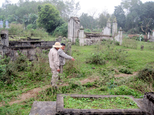 Local resident shows team members the location of unexploded ordnance in their family's graveyard.