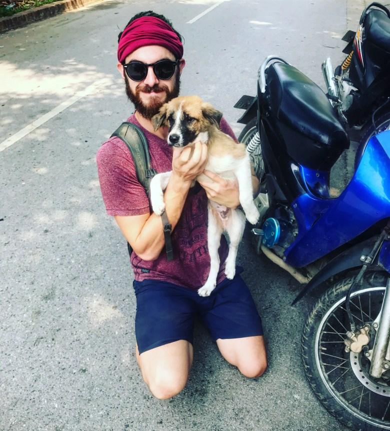 Traveller with a puppy, Luang Prabang, Laos