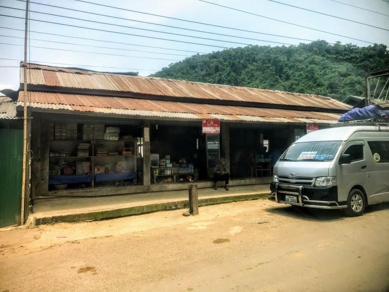 Tourist van outside restaurant, Laos