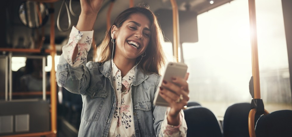 Woman listening to her phone on a bus