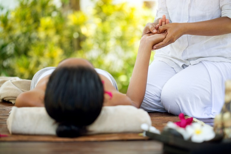 Getting a Balinese massage, iStock