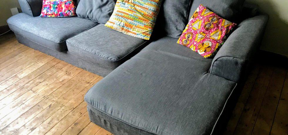 After: Reupholstered grey sofa