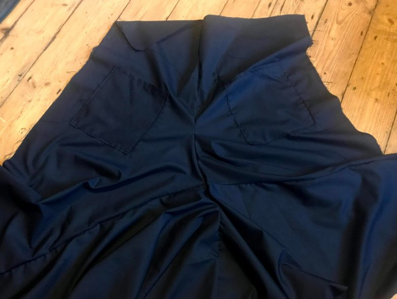 Trousers sewn at the crotch