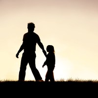 Father and child in silhouette