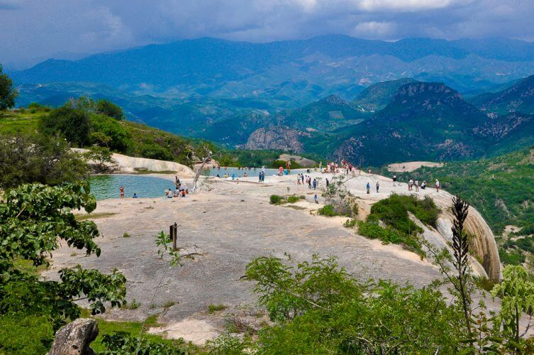 A shot of people swimming in the natural pools in Hierve el Agua