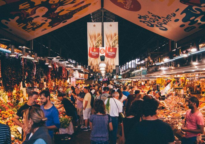 An image showcasing La Boqueria, the largest food market in Europe. Spain is synonymous with seafood and this is a great place to start