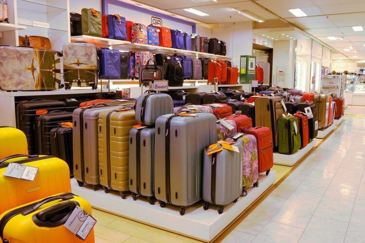A picture of different suitcases which the best luggage scale has to be able to weigh
