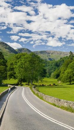 A picture of a road in the lake district shot in the month of June