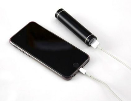 A picture of a phone connected to one of the best external batteries.