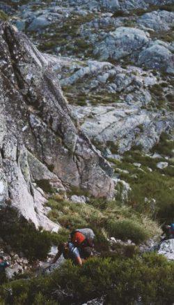 A group of trekkers climbing a steep mountain