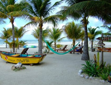 An image of hammocks and boats on the beach at Isla Holbox Mexico