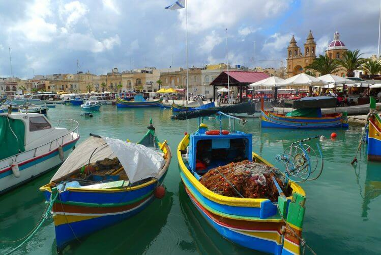 The iconic fishing boats of Malta are displayed here