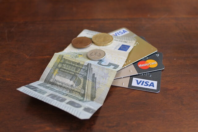 A picture of credit cards & cash