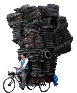 Image of bike overloaded with tyres - LEJOG What to take