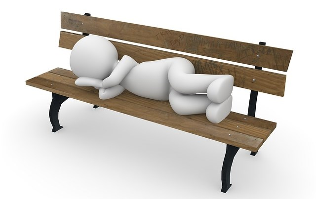 Lands End to John O'Groats Cycle Guide - Where to Sleep - Man sleeping on bench