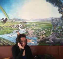 Emma with an Icelandic horrorscape at Café Loki.