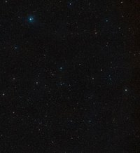 Bintang GJ 1214 yang dipotret dalam 2 filter biru dan merah. Citra diambil dengan jarak 7 tahun. Kredit : ESO/Digitized Sky Survey 2