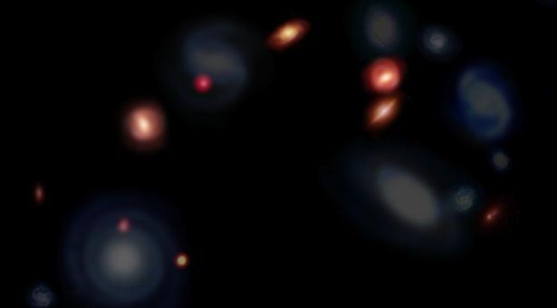 Dengan menggunakan teleskop ALMA para astronom menemukan kelompok 'galaksi normal' yang belum pernah dilihat sebelumnya, yang dulu bersembunyi di balik awan-debu tebal. Dalam ilustrasi ini galaksi-galaksi baru diberi warna merah, sedangkan galaksi-galaksi yang berwarna biru dipotret dengan menggunakan teleskop yang mendeteksi cahaya-tampak. Kredit: ALMA (ESO/NAOJ/NRAO)/ Kyoto University.
