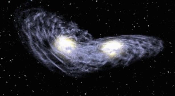 Ilustrasi galaksi yang bertabrakan dan bergabung. Kredit: NAOJ