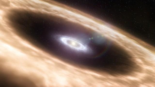 Ilustrasi tata surya saat masih dalam proses pembentukan. Di tengah-tengah terdapat bintang, sedangkan materi batuan di bagian cincin suatu saat nanti akan menjadi planet.