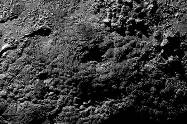 Gunung api es Wright di Pluto. Kredit: NASA/Johns Hopkins University Applied Physics Laboratory/Southwest Research Institute