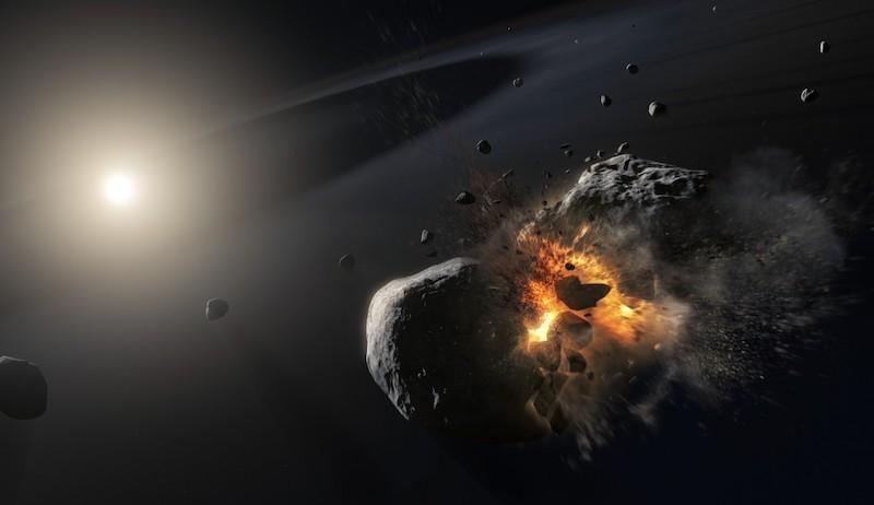 Tabrakan dua objek es seukuran asteroid yang menghasilkan terbentuknya awan debu di Fomalhaut. Kredit: SA/NASA, M. Kornmesser