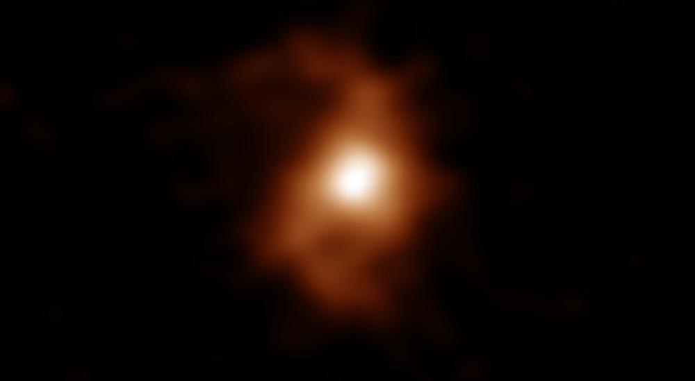 ALMA mendeteksi ion karbon dari galaksi jauh BRI 1335-0417. Kredit: ALMA (ESO/NAOJ/NRAO), T. Tsukui & S. Iguchi