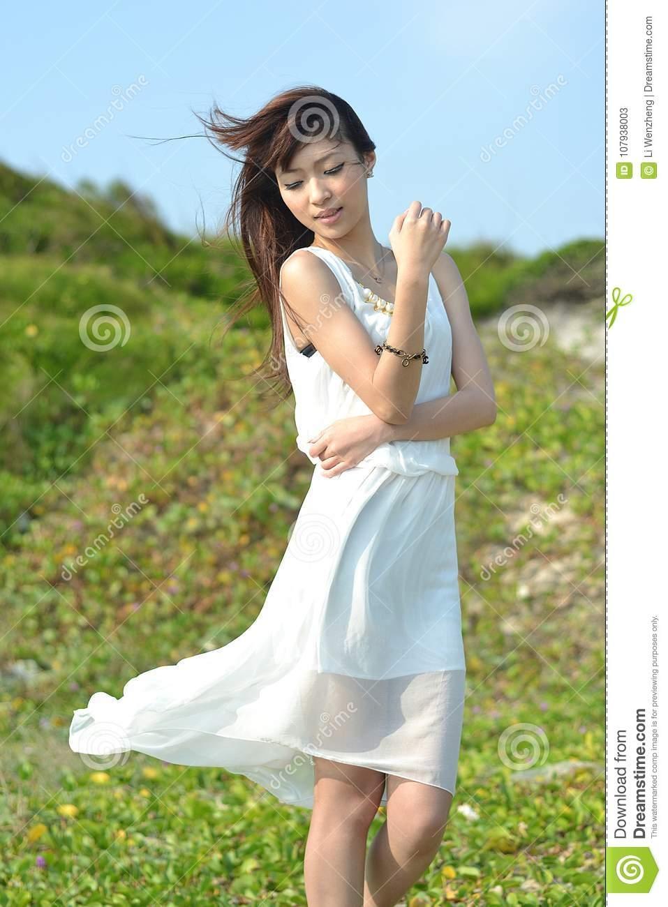 beautiful asian girl playing on the beach stock image