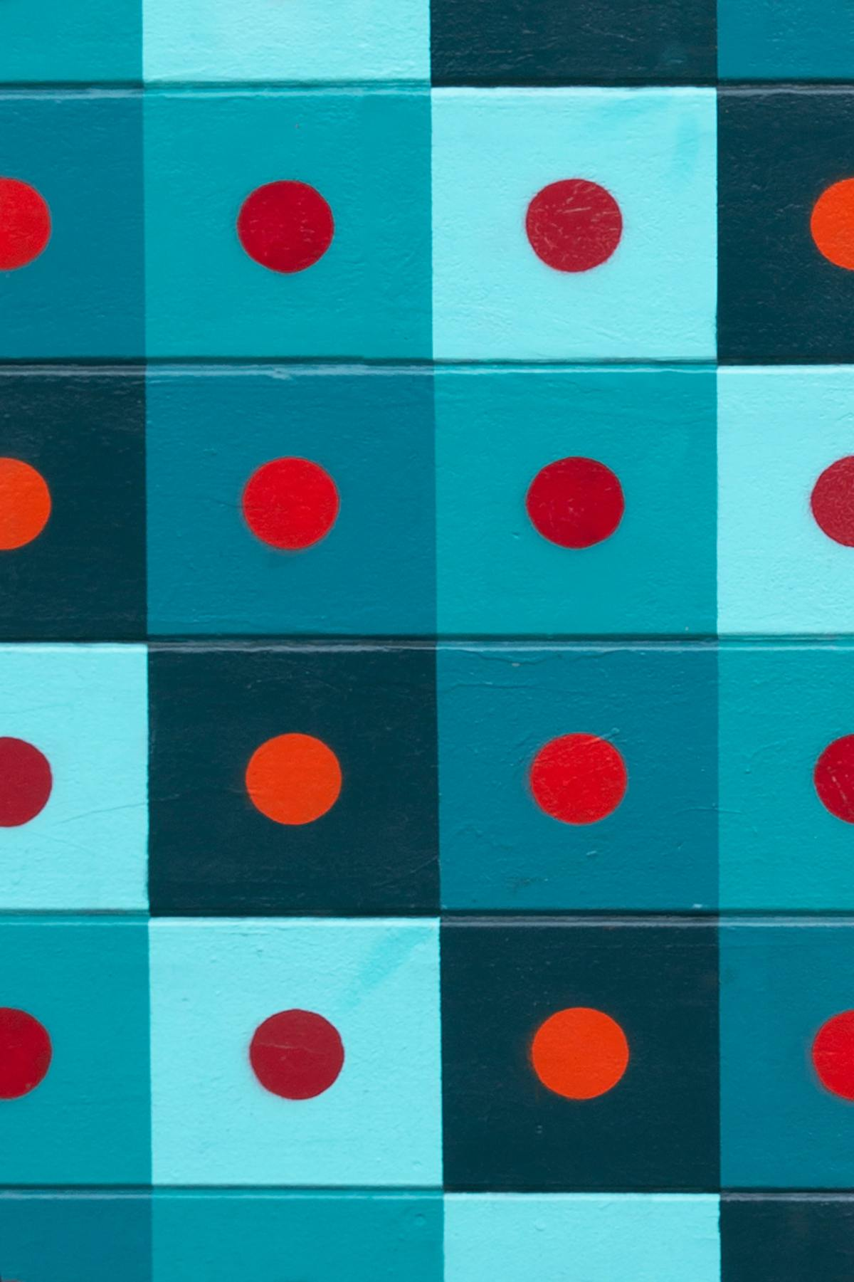Geometric mural, blue and green squares with red dots