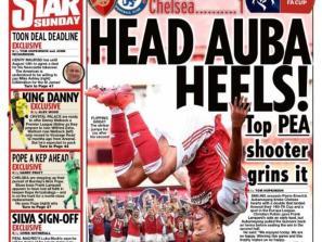 Newspaper Headline: Head Auba Heels