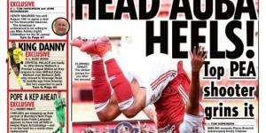 Newspaper Headline: Head Auba Heels