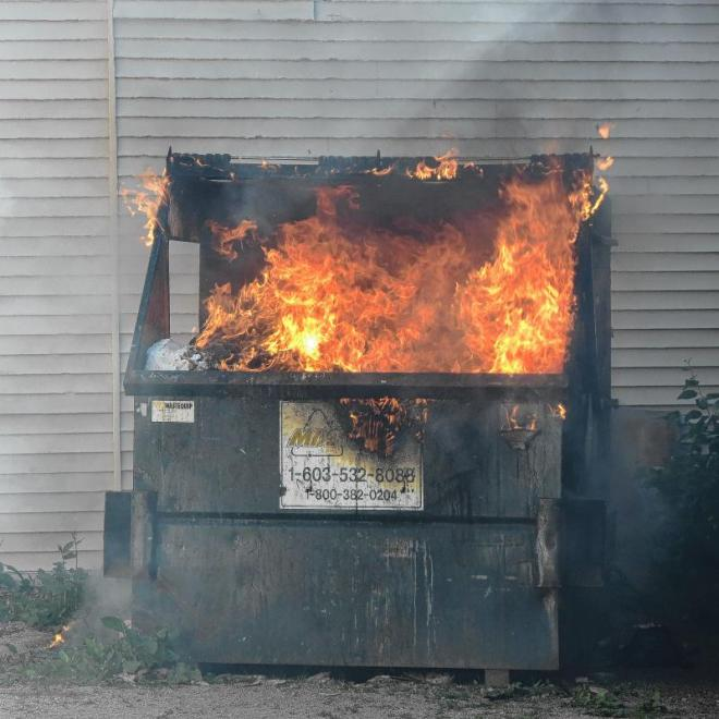 A flaming dumpster.