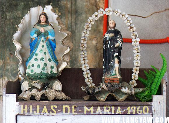 Catholic images embelished with shells.
