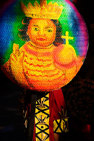 The image of the Sto. Nino, Cebu's icon, is painted on a <strong>bilao</strong> as part of a prop during a Sinulog performance