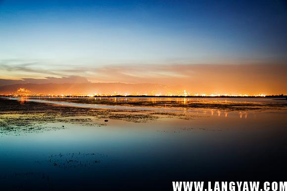 Cebu City lights cast an orange hue as dusk settles in.